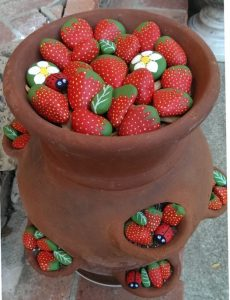 strawberry planter pot with painted strawberry rocks for your garden