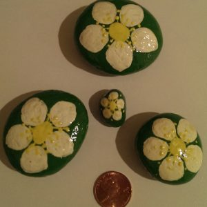 painted strawberry flower rocks for home decor or for your garden