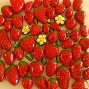 painted strawberry rocks for home decor or for your garden