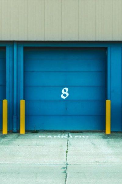 three blue storage unit doors
