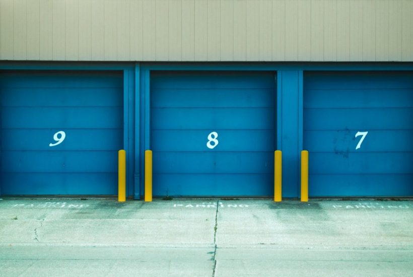 three blue storage unit doors